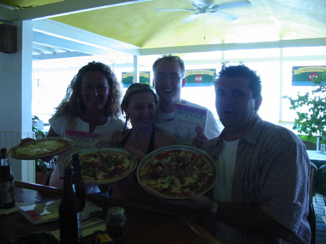 The gang and our free pizzas at the Big Banana.
