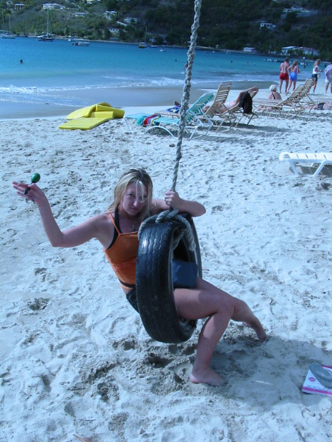 Elle in the tire swing.  Check out her Maraca!